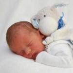 Baby Kopf mit Stofftier